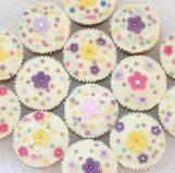 Spring Flowers muffins - Lemon sponge cakes flavoured with freshly grated lemon zest, coated with a lemon butter cream made with freshly squeezed lemon juice, and decorated with hand cut flowers, sprinkles and silver balls.