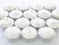 wedding muffins - Lemon sponge cakes flavoured with freshly grated lemon zest, coated with lemon icing made with freshly squeezed lemon juice, and decorated with hand cut flowers and hearts, and silver balls.