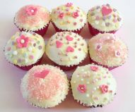pink foil muffins - Chocolate Fudge Cake with white chocolate topping, and decorated with hand cut flowers, sprinkles and pink sugar.