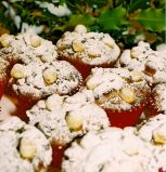 Nutty muffins - Our nutty fruit cake is rich with moist dates, apricots and vine fruits, walnuts and hazelnuts, topped with extra hazel nuts.  May be dusted with icing sugar to give a seasonally festive look at Christmas time.