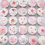 sponge muffins - A traditional Victoria sponge mixture, flavoured with a hint of fresh lemon zest, decorated with white icing, hand cut flowers and sprinkles.