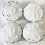 sponge muffins - A traditional Victoria sponge mixture, flavoured with a hint of fresh lemon zest, decorated with white icing, hand cut flowers and horseshoes.