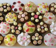 mixed sweeties - A selection of sponge and chocolate muffins decorated with a variety of different toppings and sweeties.