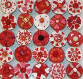 Red Heart Cakes - Muffins topped with red butter icing or white glace icing, sweeties, red hearts and sprinkles.