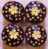 Chocolate Spring Flowers - Our best selling chocolate fudge cake made as muffins and topped with a sophisticated ganache, which isn't over sweet.  Decorated with hand made sugar flowers.