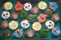 Jungle Animals - Our best selling chocolate fudge cake made as muffins and topped with a variety of icings and hand made Jungle Animal theme decorations.