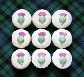 White Thistle Cakes - Thistles individually made and hand painted to decorate these white lemon sponge cakes.