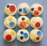 Button Cakes - Lemon Sponge cup cakes topped with lemon butter icing and decorated with hand made buttons.