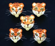 Tigers - Plain sponge cakes decorated as tiger faces.