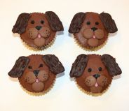 Dog Cakes - Our popular Chocolate Fudge Cake with milk chocolate topping and decorated as dog faces.