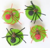 Spider Cakes - Our moist chocolate fudge cake topped with grass green butter icing and steeties arranged to look like spiders.