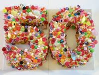 50 Sweetie Cake - Traditional all butter Victoria Sponge cake cut in the shape of a number 5, filled with jam, coated with real butter icing and encrusted with sweeties.  Size of each number approx. 9