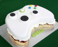 X Box Cake - Our all butter Victoria sponge cake filled with raspberry conserve and lashings of whipped cream, cut to shape and decorated to look like an X Box.