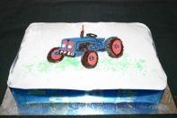 Tractor Cake - Our traditional all butter Victoria Sponge cake, layered with jam, and topped with glace icing.