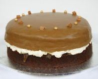 Butterscotch Cake - A moist cake made with butterscotch, layered with whipped cream and butterscotch sauce and topped with butterscotch frosting.