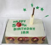 Cricket Cake - All butter lemon sponge, filled with zingy lemon curd and iced with a lemon glace icing.  Decorations include a hand made cricket ball and bat.