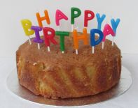 Lemon Drizzle Cake - Our best selling all butter lemon drizzle cake here simply decorated with the addition of candles.