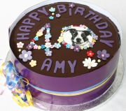 Collie Dog Cake - Our best selling cake, which we make in all shapes and sizes.  A moist chocolate cake with a melt in the mouth chocolate ganache topping.  A sophisticated cake, because it is not over sweet. Here it is decorated with a hand painted portrait of a family pet collie dog and flowers