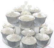 Wedding muffins - Lemon sponge cake flavoured with freshly grated lemon zest, coated with lemon icing made with freshly squeezed lemon juice, made in silver foil cases and decorated with hand made flowers, hearts, dove and silver balls.