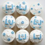 Blue & White Muffins - Our all-butter lemon sponge is made with freshly grated lemon zest, and the juice is used to make the tangy lemon icing.  Decorated for a wedding with some hand made decorations.