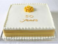 Golden Anniversary - A rich Fruit cake using dried fruit soaked in brandy and our own home made rich Almond paste.  Hand made yellow roses were requested to remind them of their own wedding cake.