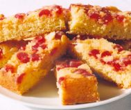 Cherry & Almond Cake - An almond cake baked upside down, so that the finished cake is encrusted with a rich topping of glossy ruby red glace cherries and crunchy flaked almonds.