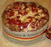 Cherry & Almond Cake - An almond cake baked upside down, so that the finished cake is encrusted with a rich topping of glossy ruby red glace cherries and crunchy flaked almond.