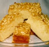 Pine Nut cake - A sponge cake with a crust of pine nuts and honey.