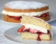 Strawberry Sponge Cake - A traditional sponge cake filled with seedless raspberry jam, lashings of fresh whipped cream and sliced fresh strawberries.  Summer time only for the best strawberries.