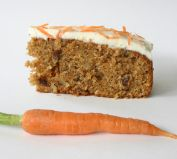 Carrot Cake - A moist cake, dense with grated carrot, chopped walnuts and sultanas,  flavoured with mixed spices and a hint of coconut, and topped with a delicious smooth cream cheese topping.  Ideal for those who want their cake full of nutritious ingredients, rather than a sugar blast.