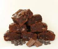 Choc Chip Brownies - Hedonistic chocoholic's heaven.  Gooey chocolate brownies with extra chocolate chips (white, milk, dark or all three!) of your choice.