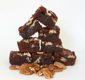 Choc & Pecan Brownies - Rich chocolate brownies made with lots of melted dark chocolate, pecan nuts to add some crunch and not excessively sweet.  We make these in either a dense gooey version or a slightly shallower, lighter version.