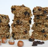 Raisin and Sesame Flapjacks - A variation on our popular Flapjack recipe, made with Scotts oats, sticky golden syrup and hazelnuts, but also enriched with toasted sesame seeds and chewey raisins.
