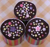 Choc Spring Flowers - Our best selling moist chocolate fudge cake with a rich ganache topping.  Here made as 4