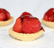 Strawberry tartlets - Home made (of course) rich shortcrust pastry tartlet case piled with fresh strawberries and glazed with just enough jam to sweeten it.