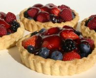 Summer Berry Tarts - Home made rich shortcrust pastry individual (11 cm) tarts, piled with summer berries and glazed with just enough jam to sweeten it.