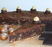 Chocolate & Hazelnut Tart - Home made sweet shortcrust pastry filled with a rich dark chocolate filling, dense with roasted ground hazelnuts.