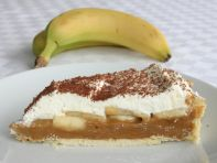 Banoffee Pie - Home made rich shortcrust pastry filled with layers of caramel toffee, freshly sliced bananas and whipped cream, and finished with grated dark chocolate.  This can also be made with a biscuit crust base, if preferred.