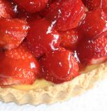 Strawberry & Custard Tart - Home made (of course) rich shortcrust pastry case filled with our own confectioners' custard recipe, layered with sliced fresh strawberries and drizzled with just enough jam to sweeten it and give it a sparkling glaze. Summer time only.  Other berries could also be used.