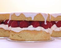 Raspberry Almond Layer - A moist, light almond sponge filled with lashings of whipped cream and fresh raspberries.  Can be made as individual portions, 9