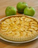 french Apple Flan - Home made rich shortcrust pastry tart filled with sliced apples and coated with an apricot glaze.