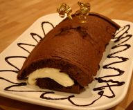 Chocolate Roulade - A rich chocolate roulade, filled with chocolate sauce and whipped cream.
