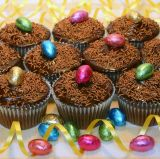 Easter Muffins - Chocolate Fudge cake topped with glossy ganache and decorated with mini foil coated chocolate eggs.