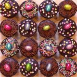 Easter muffins - Our very popular Chocolate Fudge Cake topped with dark chocolate ganache, foil wrapped chocolate mini eggs and sprinkles.