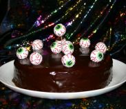Eyeball Cake - Chocolate cake decorated with a glossy ganache topping and foil wrapped eyeballs!