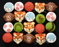 Mixed Muffins - A mixture of Chocolate and sponge muffins decorated with  a variety of animals, flowers and bright bling.