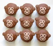 Monkey Cakes - Our popular chocolate fudge cake decorated with milk chocolate topping and monkey faces.