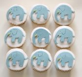 Elephant Cakes - Victoria Sponge cakes decorated with blue hand cut elephants.