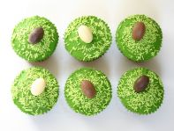 Rugby Balls - Chocolate fudge cake topped with grass green butter icing, sprinkles and 'rugby balls'.