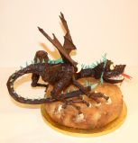 Dragon Cake - Chocolate sculpture of a dragon on a lemon drizzle cake.